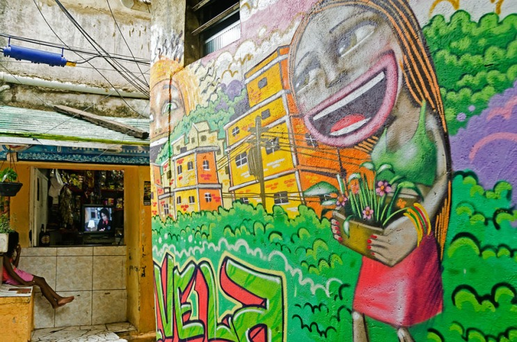 Girl watching television in a favela in Rio de Janeiro